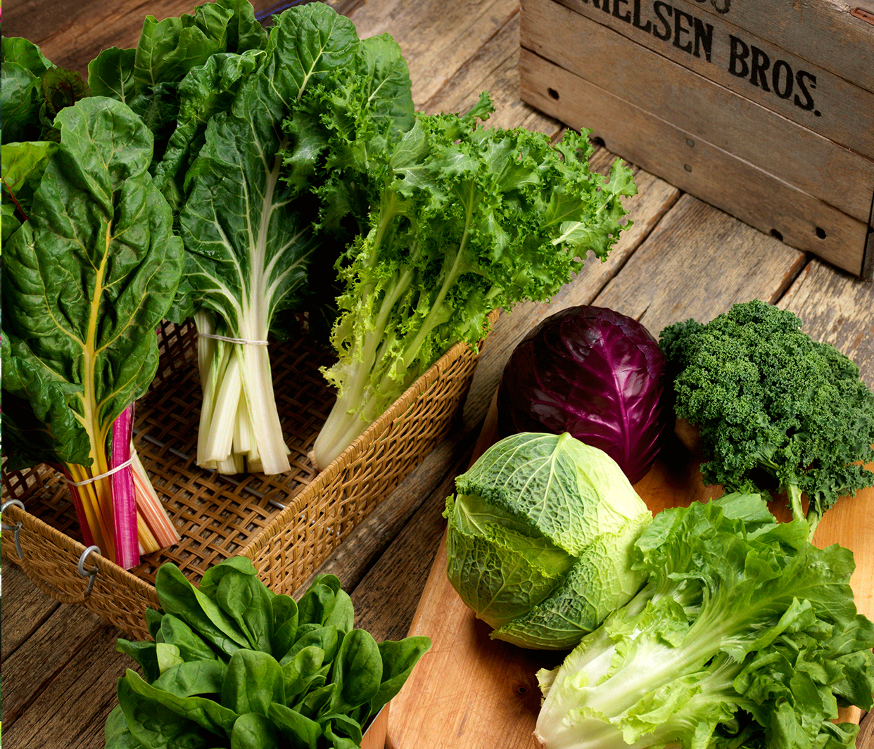 an assortment of leafy green vegetables including chard, escarole, endive, cabbbage, kale and spinach